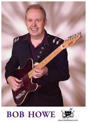 Bob Howe - promo photo with guitar